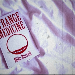 Strange Medicine – Mike Russell